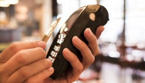 Male Close-up electronic payment hand cell phone
